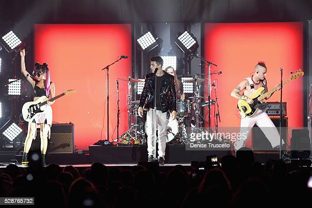 JinJoo Lee singer Joe Jonas Cole Whittle and Jack Lawless of DNCE perform during opening night of the Selena Gomez 'Revival World Tour' at the...