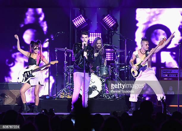 JinJoo Lee singer Joe Jonas Jack Lawless and Cole Whittle of DNCE perform during opening night of the Selena Gomez 'Revival World Tour' at the...