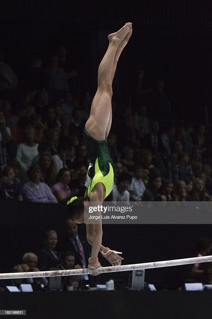 Jinnan Yao of China competes l in the Uneven Bars Final on Day Six of the Artistic Gymnastics World Championships Belgium 2013 held at the Antwerp Sports Palace on October 5, 2013 in Antwerpen, Belgium. Jorge Luis Alvarez Pupo/LatinContent/Getty Images)