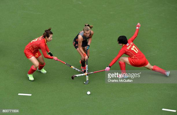 Jinrong Zhang and Xiayun Xi of China and Xan de Waard of Netherlands during the FINTRO Women's Hockey World League SemiFinal Pool A game between...