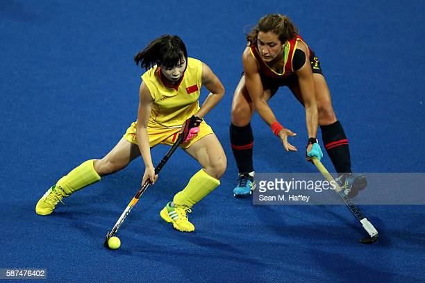 Jinrong Zhang of China competes with Lola Riera of Spain during a Women's Pool A match on Day 3 of the Rio 2016 Olympic Games at the Olympic Hockey...