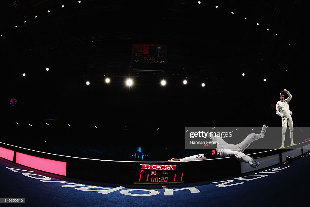 Jinsun Jung of Korea left celebrates victory in the Men's Epee Individual Fencing Bronze medal match against Seth Kelsey of the United States on Day 5 of the London 2012 Olympic Games at ExCeL on August 1, 2012 in London, England.