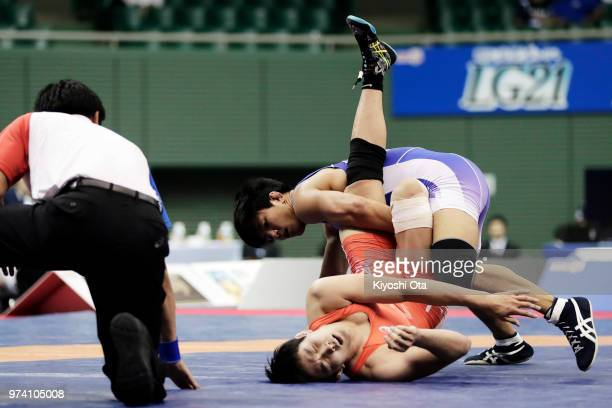 Jintaro Motoyama competes against Keisuke Otoguro in the Men's Freestyle 70kg final on day one of the All Japan Wrestling Invitational Championships...