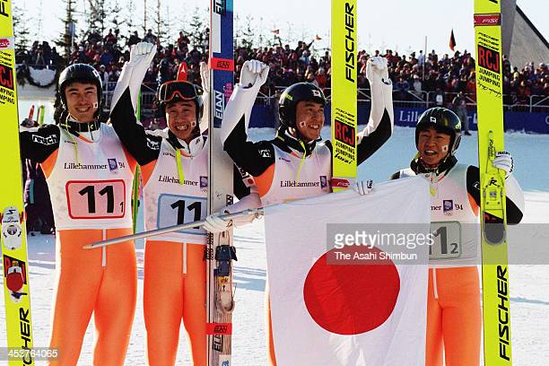 Jinya Nishikata Masahiko Harada Noriaki Kasai and Takanobu Okabe of Japan celebrate winning silver in the Ski Jumping Team competition during the...