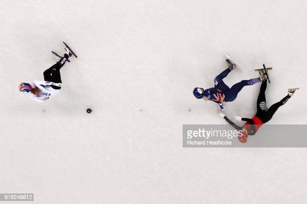 Jinyu Li of China and Elise Christie of Great Britain fall after contact as Minjeong Choi of Korea skates past during the Short Track Speed Skating...