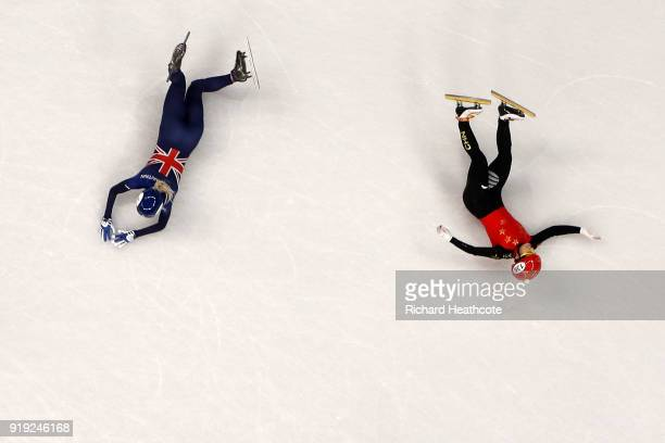 Jinyu Li of China and Elise Christie of Great Britain fall after contact during the Short Track Speed Skating Ladies' 1500m Semifinals on day eight...