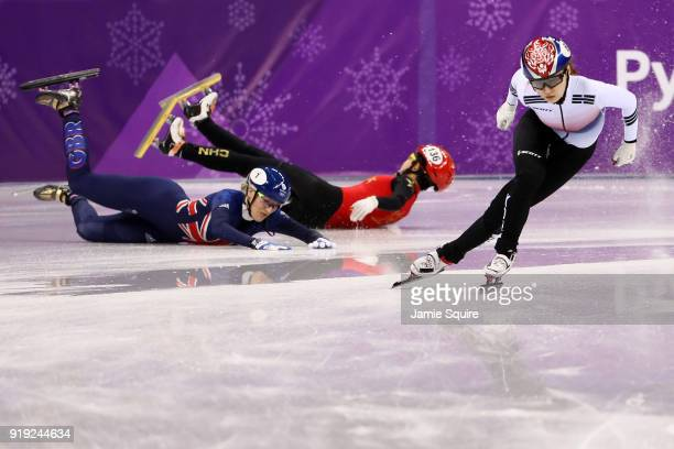Jinyu Li of China and Elise Christie of Great Britain fall as Minjeong Choi of Korea skates past during the Short Track Speed Skating Ladies' 1500m...