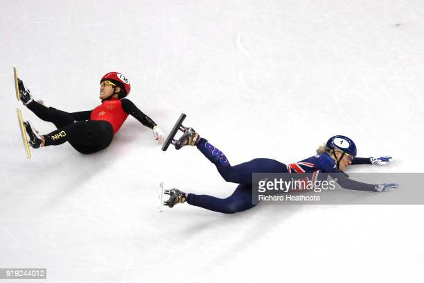 Jinyu Li of China and Elise Christie of Great Britain fall during the Short Track Speed Skating Ladies' 1500m Semifinals on day eight of the...