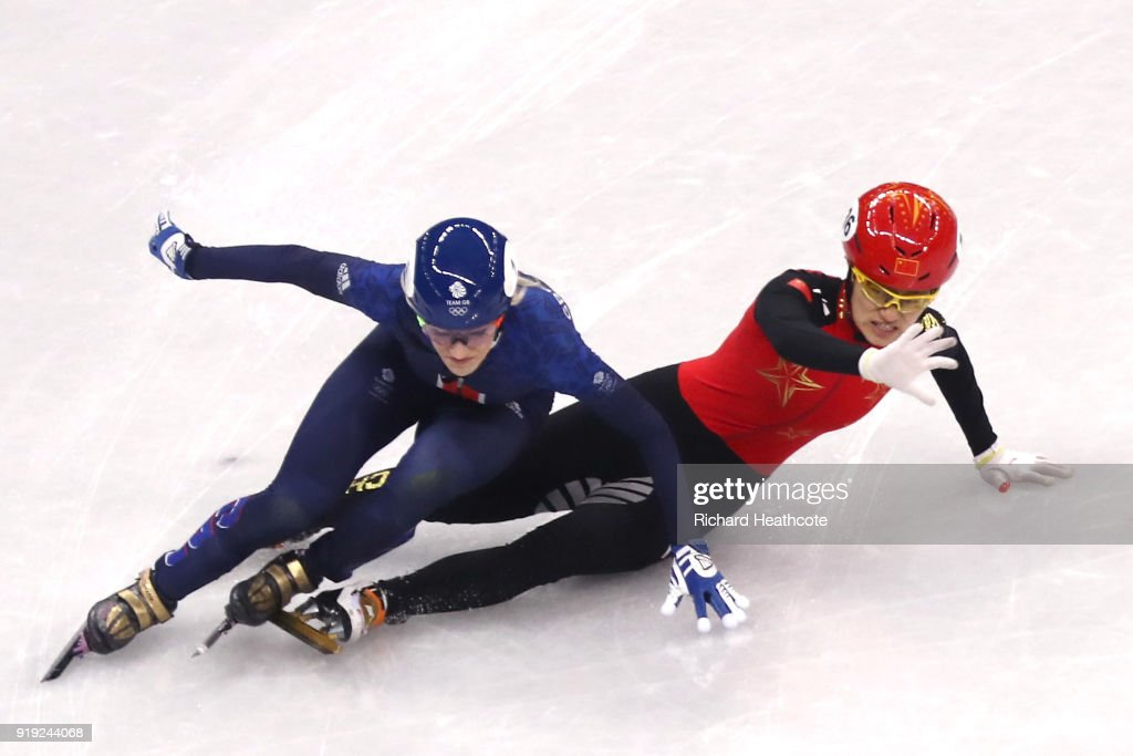 Jinyu Li of China and Elise Christie of Great Britain fall during the Short Track Speed Skating Ladies' 1500m Semifinals on day eight of the PyeongChang 2018 Winter Olympic Games at Gangneung Ice Arena on February 17, 2018 in Gangneung, South Korea.