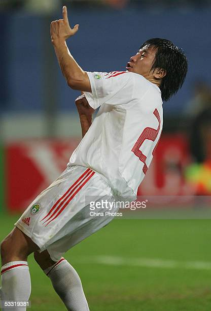 Jinyu of China celebrates after scoring against Japan during a match in the East Asian Football Championship on August 3, 2005 in Daejeon, South...