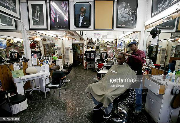 Jioe Randle gets a haircut from Leon Williams at Goof Fred Barber Shop in the South Los Angeles neighborhood known as Chesterfield Square. Per...