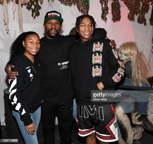 "Jirah Mayweather, her father, boxing promoter Floyd Mayweather Jr., and his son ""King"" Koraun Mayweather pose with a prop zombie after they went..."