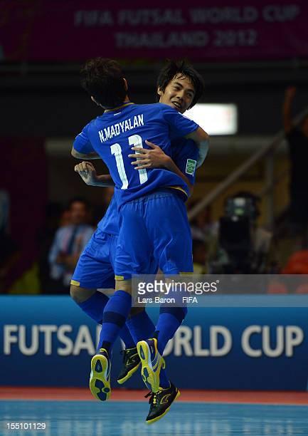 Jirawat Sornwichian of Thailand celebrates with team mate Nattavut Madyalan after scoring his teams third goal during the FIFA Futsal World Cup Group...
