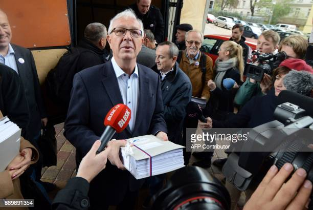 Jiri Drahos Czech former Czech Science Academy head and independant candidate for the presidential election talks to the press as he arrives at the...