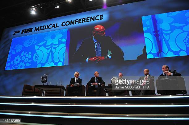 Jiri Dvorak FIFA Chief Medical Officer Referee Howard Webb Jonathan Tobin Doctor of Bolton Football Club Craig Hulse amature football player Kansas...