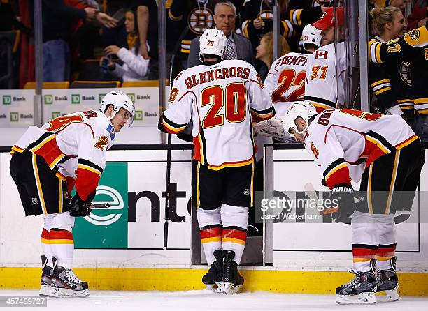 Jiri Hudler and Mark Giordano of the Calgary Flames skate off of the ice following their 20 loss to the Boston Bruins during the game at TD Garden on...