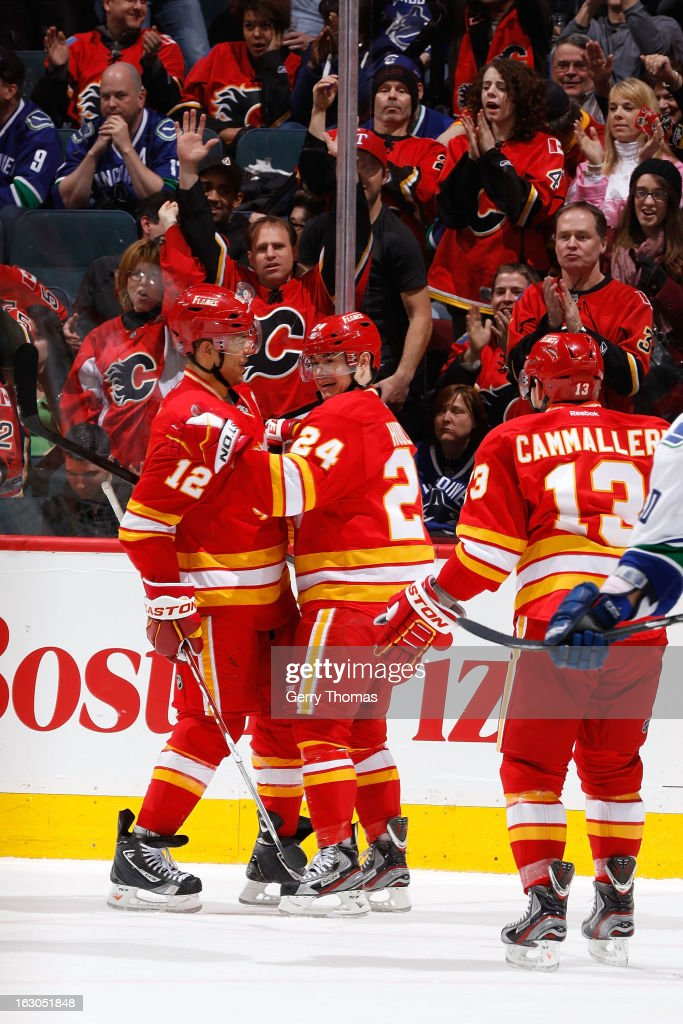 Jiri Hudler #24, Jarome Iginla #12 and Michael Cammalleri #13 of the Calgary Flames celebrate a goal against the Vancouver Canucks on March 3, 2013 at the Scotiabank Saddledome in Calgary, Alberta, Canada.