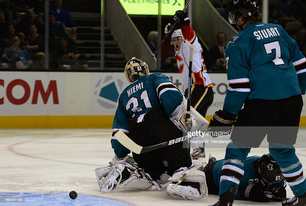 Jiri Hudler #24 of the Calgary Flames celebrates after he scored a goal on goalkeeper Antti Niemi #31 of the San Jose Shark during the third period at SAP Center on October 19, 2013 in San Jose, California.
