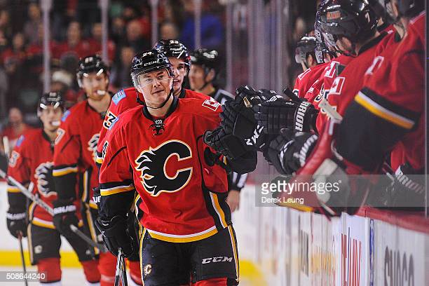 Jiri Hudler of the Calgary Flames celebrates with the bench after scoring against the Columbus Blue Jackets during an NHL game at Scotiabank...