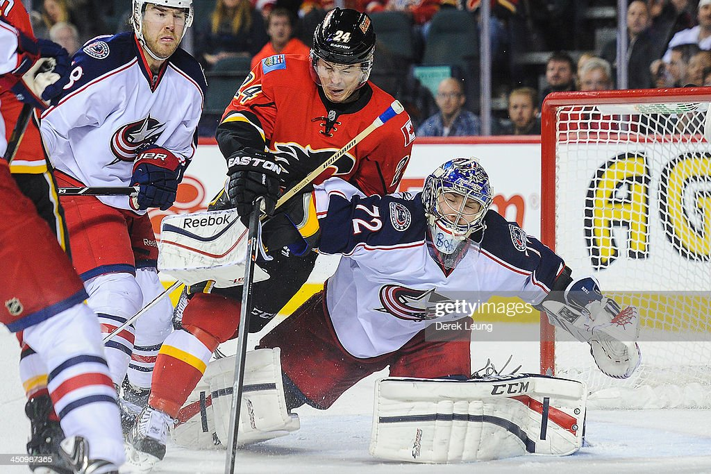 Jiri Hudler #24 of the Calgary Flames crashes into Sergei Bobrovsky #72 of the Columbus Blue Jackets during an NHL game at Scotiabank Saddledome on November 20, 2013 in Calgary, Alberta, Canada. The Blue Jackets defeated the Flames 2-1 in overtime.