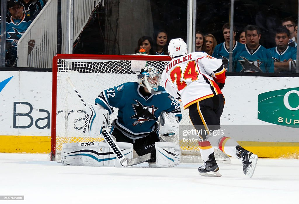 Jiri Hudler #24 of the Calgary Flames scores the game winner in the shoot out against Alex Stalock #32 of the San Jose Sharks during a NHL game at the SAP Center at San Jose on February 11, 2016 in San Jose, California.