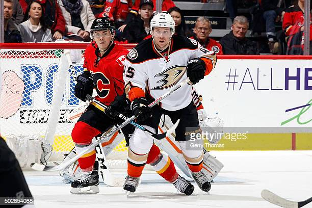 Jiri Hudler of the Calgary Flames skates against Sami Vatanen of the Anaheim Ducks during an NHL game at Scotiabank Saddledome on December 29 2015 in...