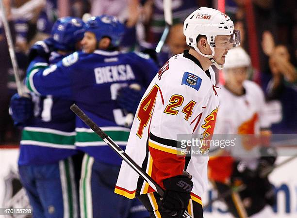 Jiri Hudler of the Calgary Flames skates by the Vancouver Canucks celebrating Ronalds Kenins's goal during Game Two of the Western Conference...