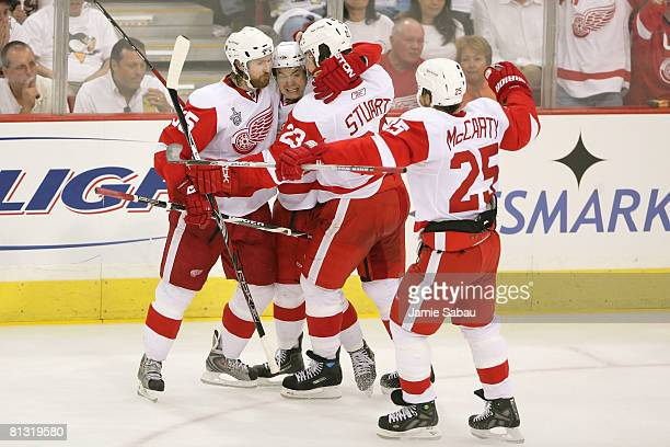 Jiri Hudler of the Detroit Red Wings celebrates with teammates Brad Stuart Darren McCarty and Niklas Kronwall Hudler scored a third period goal past...