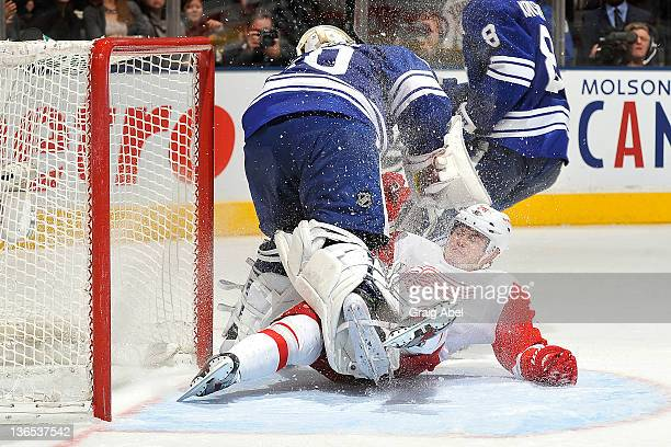 Jiri Hudler of the Detroit Red Wings collides with Jonas Gustavsson of the Toronto Maple Leafs during NHL game action January 7 2012 at Air Canada...