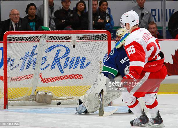 Jiri Hudler of the Detroit Red Wings scores the gamewinning goal on Roberto Luongo of the Vancouver Canucks during the shootout at Rogers Arena on...