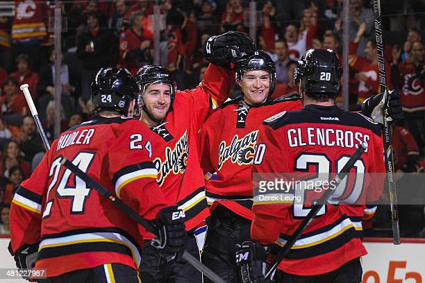 Jiri Hudler TJ Brodie Joe Colborne and Curtis Glencross of the Calgary Flames celebrate Joe Colborne's goal against the New York Rangers during an...