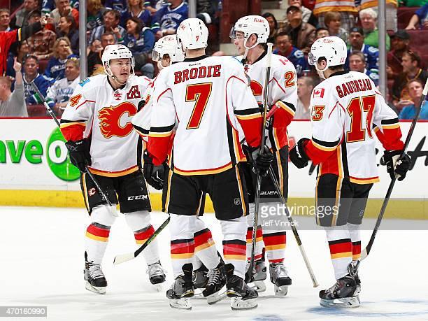 Jiri Hudler TJ Brodie Johnny Gaudreau and Sean Monahan of the Calgary Flames congratulate Kris Russell of the Calgary Flames who scored against the...