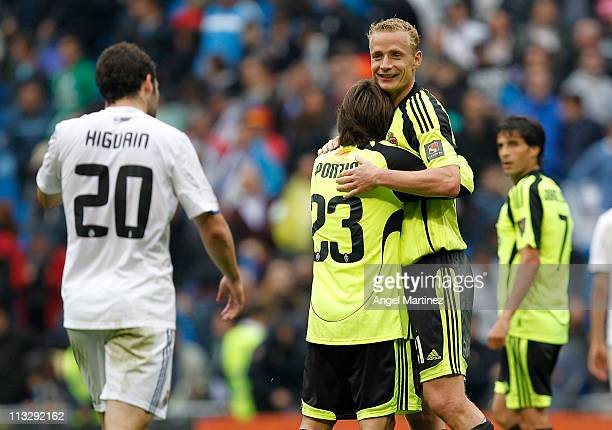Jiri Jarosik and Leonardo Ponzio of Real Zaragoza celebrate at the end of the La Liga match between Real Madrid and Real Zaragoza at Estadio Santiago...
