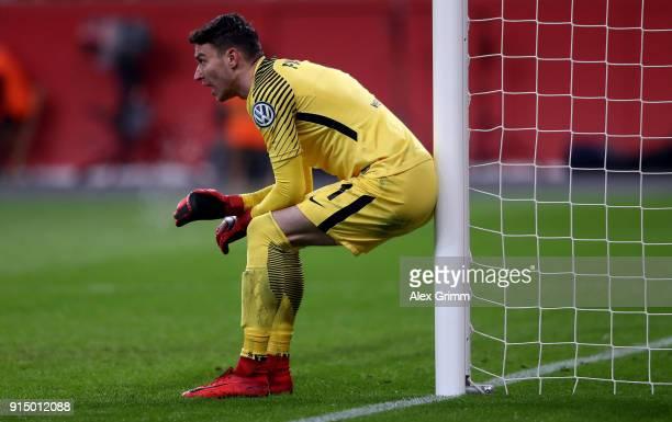Jiri Pavlenka goalkeeper of Bremen gestures during the DFB Cup quarter final match between Bayer Leverkusen and Werder Bremen at BayArena on February...