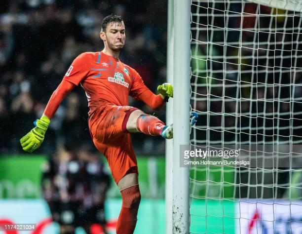 Jiri Pavlenka of Bremen is disappointed during the Bundesliga match between Eintracht Frankfurt and SV Werder Bremen at Commerzbank-Arena on October...