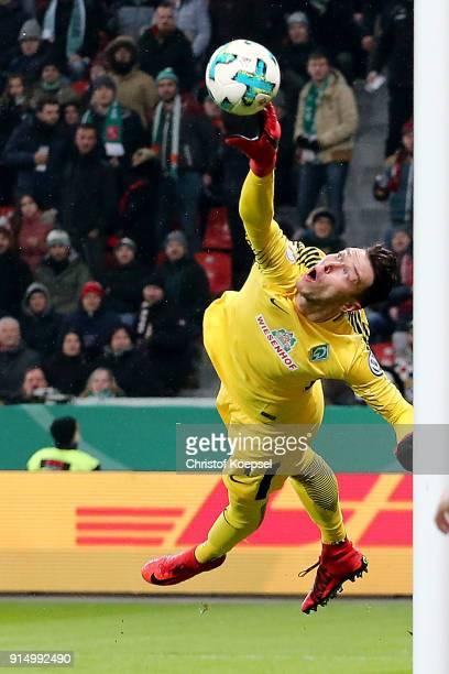 Jiri Pavlenka of Bremen saves a ball during the DFB Cup quarter final match between Bayer Leverkusen and Werder Bermen at BayArena on February 6 2018...
