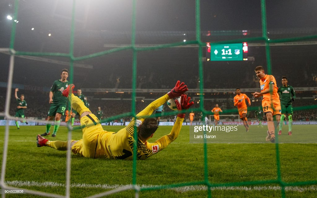 Jiri Pavlenka of Bremen saves a shot of Andrej Kramaric of Hoffenheim during the Bundesliga match between SV Werder Bremen and TSG 1899 Hoffenheim at Weserstadion on January 13, 2018 in Bremen, Germany.