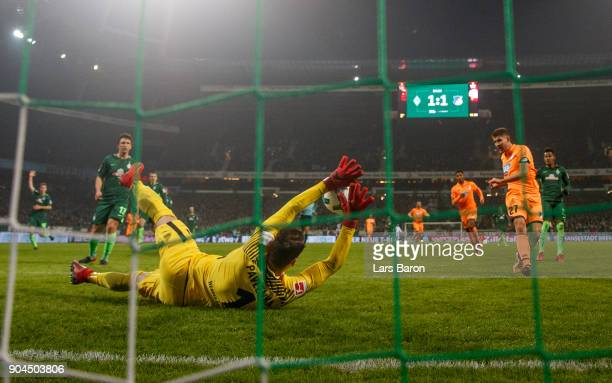Jiri Pavlenka of Bremen saves a shot of Andrej Kramaric of Hoffenheim during the Bundesliga match between SV Werder Bremen and TSG 1899 Hoffenheim at...