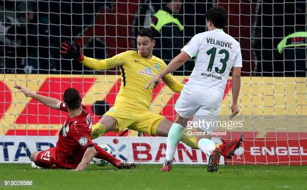 Jiri Pavlenka of Bremen saves against a shot of Dominik Kohr of Leverkusen during the DFB Cup quarter final match between Bayer Leverkusen and Werder...