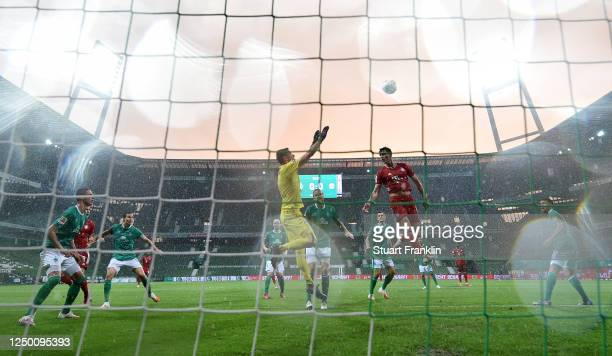 Jiri Pavlenka of SV Werder Bremen saves a header from Benjamin Pavard of Bayern Munich during the Bundesliga match between SV Werder Bremen and FC...