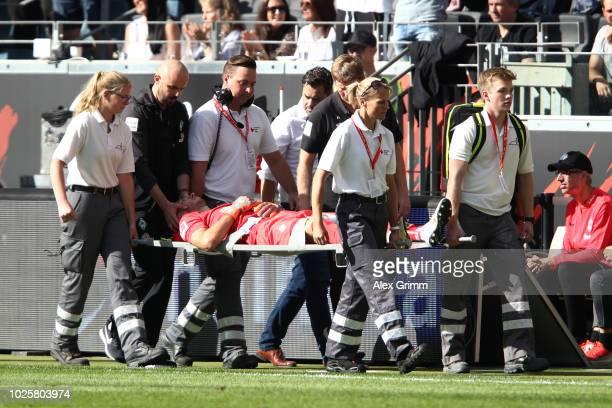 Jiri Pavlenka of Werder Bremen is stretchered off injured during the Bundesliga match between Eintracht Frankfurt and SV Werder Bremen at...