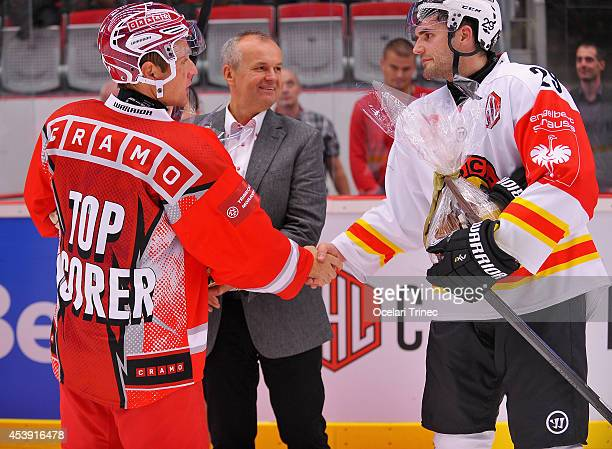 Jiri Polansky of HC Ocelari Trinec and Philippe Furrer of SC Bern during the Champions Hockey League group stage game between HC Ocelari Trinec and...