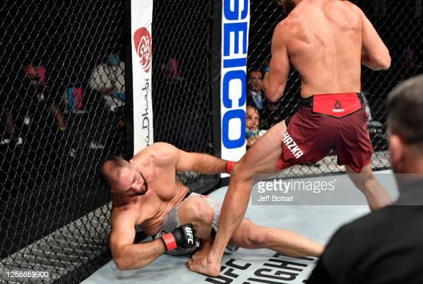 Jiri Prochazka of the Czech Republic knocks out Volkan Oezdemir of Switzerland in their light heavyweight fight during the UFC 251 event at Flash...
