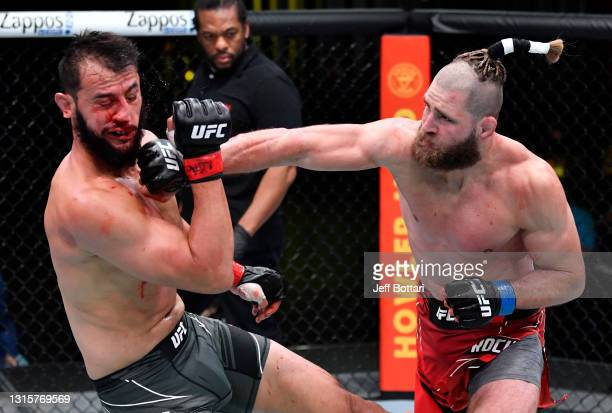 Jiri Prochazka of the Czech Republic punches Dominick Reyes in a light heavyweight bout during the UFC Fight Night event at UFC APEX on May 01, 2021...