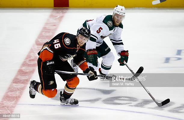 Jiri Sekac of the Anaheim Ducks and Christian Folin of the Minnesota Wild skate during the third period of a game at Honda Center on October 18 2015...