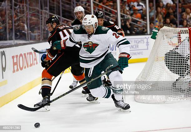 Jiri Sekac of the Anaheim Ducks and Matt Dumba of the Minnesota Wild chase the puck during the first period of a game at Honda Center on October 18...