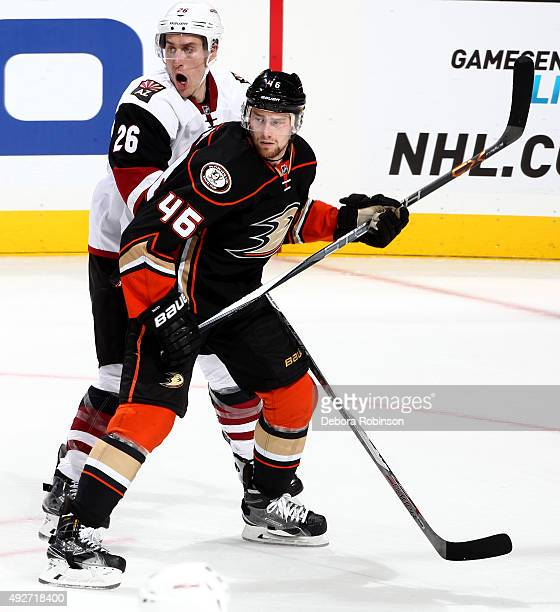 Jiri Sekac of the Anaheim Ducks battles for position against Michael Stone of the Arizona Coyotes on October 14 2015 at Honda Center in Anaheim...