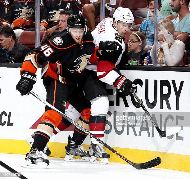 Jiri Sekac of the Anaheim Ducks battles for position against Zbynek Michalek of the Arizona Coyotes on October 14 2015 at Honda Center in Anaheim...