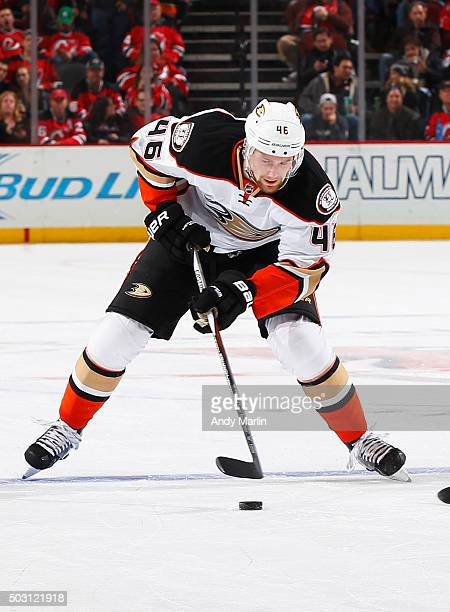Jiri Sekac of the Anaheim Ducks plays the puck against the New Jersey Devils during the game at the Prudential Center on December 19 2015 in Newark...