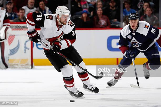 Jiri Sekac of the Arizona Coyotes controls the puck against Shawn Matthias of the Colorado Avalanche at Pepsi Center on March 7 2016 in Denver...